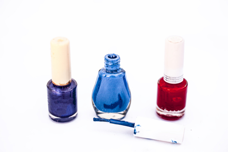 Blue,purple and red colored three nail polish bottle isolated on white. Banque d'images