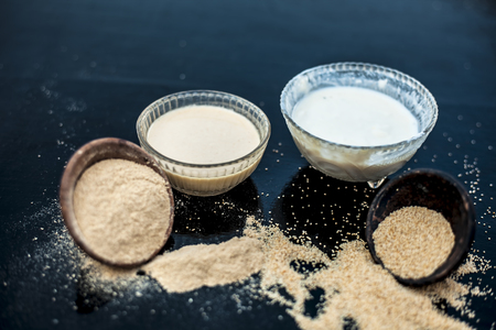 Key ingredients to make poppy seeds bread.loafdough nutsmuffinscake on wooden surface which are poppy seeds along with its powder and milk.