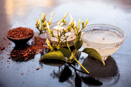 Best face pack for lightening up your face or for instant glow on wooden surface i.e. Jasmine flower leaves well mixed with sandalwood and water and curd or yogurt.