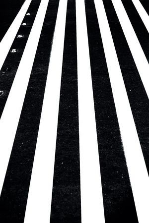 Extreme close up shot of cross walks or zebra crossing on roads.