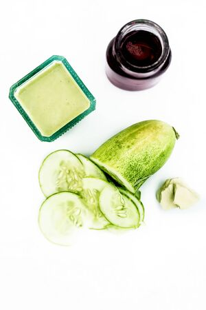 Best face pack to remove tan and to soothe sunburns isolated on white i.e. Cucumber pulp well mixed with fuller's earth powder,rose water.Entire ingredients present on the surface. Standard-Bild - 124566736