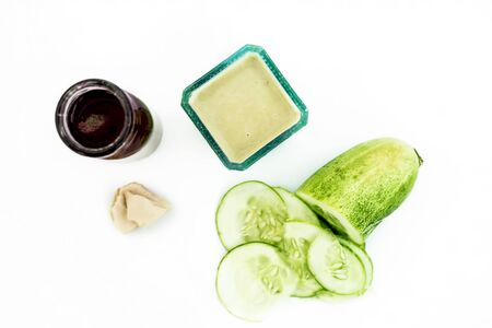 Best face pack to remove tan and to soothe sunburns isolated on white i.e. Cucumber pulp well mixed with fuller's earth powder,rose water.Entire ingredients present on the surface. Standard-Bild - 124567479