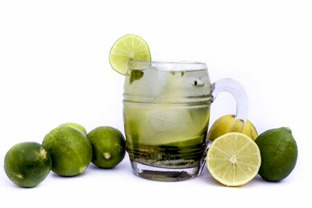 Popular Summer Drink isolated on white i.e. Virgin mint mojito with fresh lemons also.