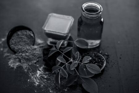 Face pack of devil's dung powder on wooden surface i.e. Hing powder well mixed with sandal wood powder or chandan and rose water.Used for the treatment for instant glow.