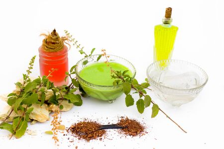 Basil face pack isolated on white i.e. Sandalwood powder well mixed with tulsi,rose water,olive oil,mulpani mitti or multani mitti.Used for the treatment or for instant glow. Stock fotó