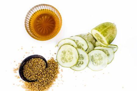 Cucumber face pack or face mask isolated on white with its entire ingredients which are oats and honey along with cucumber pulp well mixed in a glass bowl.Good for dry skin. Standard-Bild - 124568280