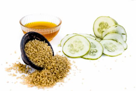 Cucumber face pack or face mask isolated on white with its entire ingredients which are oats and honey along with cucumber pulp well mixed in a glass bowl.Good for dry skin. Standard-Bild - 124568405
