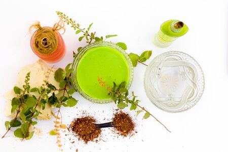 Basil face pack isolated on white i.e. Sandalwood powder well mixed with tulsi,rose water,olive oil,mulpani mitti or multani mitti.Used for the treatment or for instant glow. 版權商用圖片