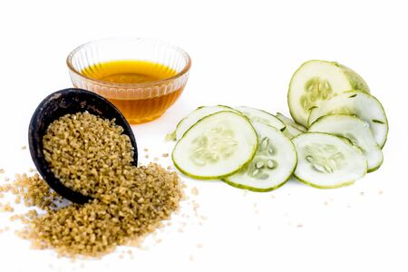 Cucumber face pack or face mask isolated on white with its entire ingredients which are oats and honey along with cucumber pulp well mixed in a glass bowl.Good for dry skin. Standard-Bild - 124568841