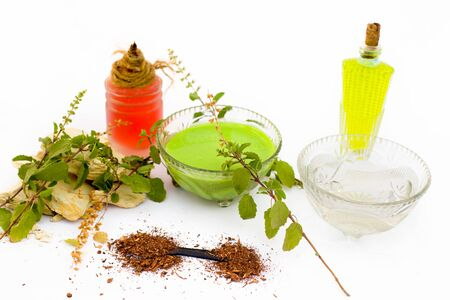 Basil face pack isolated on white i.e. Sandalwood powder well mixed with tulsi,rose water,olive oil,mulpani mitti or multani mitti.Used for the treatment or for instant glow. Imagens - 124570408
