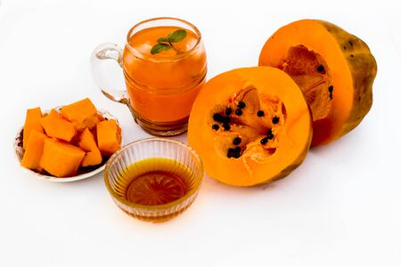Papaya juice or smoothie isolated on white with entire ingredients which are honey,and ripe papaya.