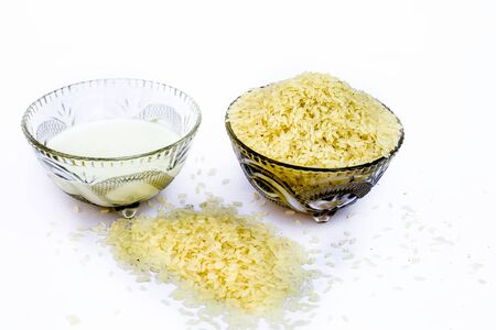 Ingredients to make popular dessert dish Kiribath made with rice and milk.The main ingredients of the dish viz. Rice and milk isolated on white.