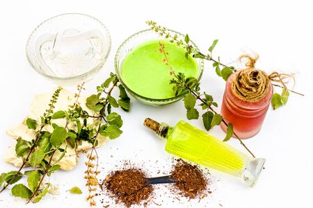 Tulsi face pack isolated on white consisting of sandal wood powder well mixed with tulsi leaves with the help of fuller earth and rose water.Used for instant glow.