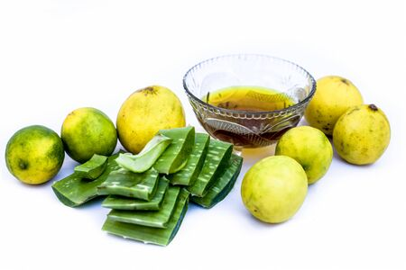 Best method to remove tan at home isolated on white i.e. Aloe vera gel well mixed with some lemon juice in it.Entire raw ingredients present on the surface.