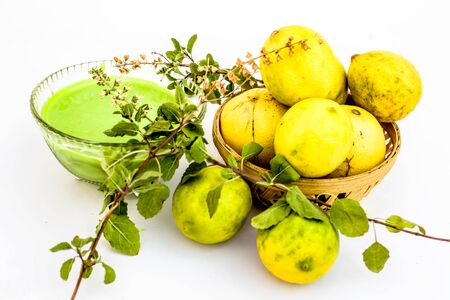 Lemon face pack isolated on white i.e. lime juice well mixed with tulsi or holy basil's juice.Used for the treatment or to remove dirt,dust and other impurities. Stock fotó
