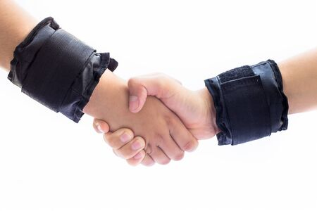 Shaking hands. Concept of teamwork and fitness isolated on white.Hands wearing black colored wrist bands.
