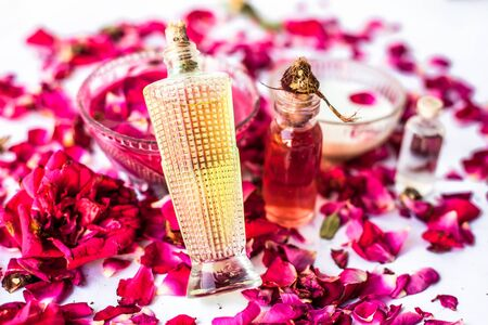Face pack or face mask to nourish and moisturises  skin isolated on white i.e. Rose essential oil well mixed with coconut oil,olive oil and milk in a glass bowl and entire raw ingredient present.