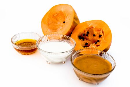 Best face pack or face mask to moisture dry skin and to clean dark spots and to reduces blemishes isolated on white i.e. papaya face mask consisting of honey,papaya pulp, and milk.