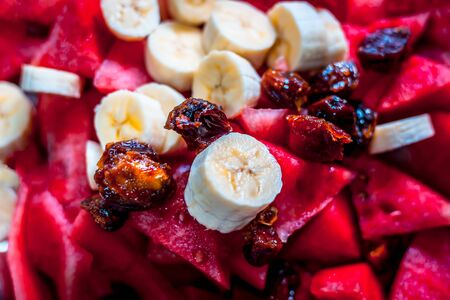 Fresh organic fruit salad mainly consisting of watermelon,dates and banana in a plate.Concept of iftar during holy Ramadan month. Foto de archivo