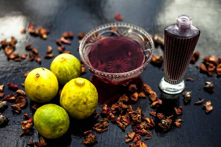 Face mask or pack on wooden surface consisting of rose water, lemon juice for acne and pimple. Horizontal shot. Stok Fotoğraf