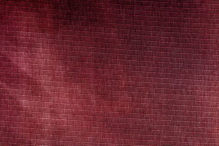 Close up shot of red colored fabric texture.