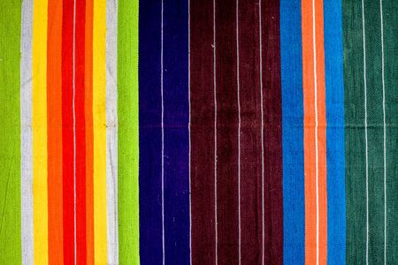 Bright fabric colorful textured background along with white colored linings on it. Reklamní fotografie