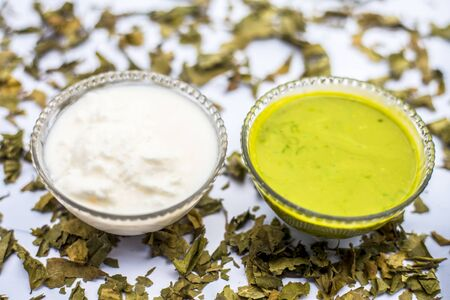 Neem or Indian Lilac face mask isolated on white for acne and scars consisting of gram flour, neem paste, and some curd.