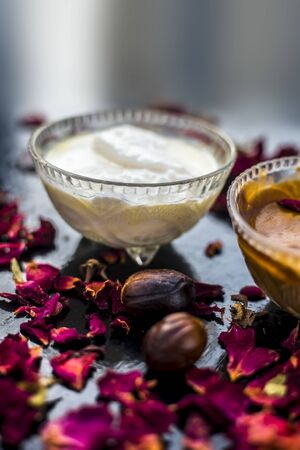 Nutmeg face mask to treat to even out discolorations and pigmentation on your face on the wooden surface consisting of Nutmeg powder, lemon juice, and curd.