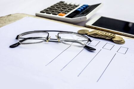 Close up of workplace of businessman or finance consultant isolated on white using credit card, cell phone, pen and calculator like things. Stok Fotoğraf