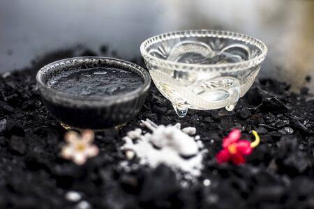Activated charcoal well mixed with baking soda to detoxify strands and scalp, restore shine, repair damaged and split ends, and promote healthy, fast hair growth.On wooden surface.