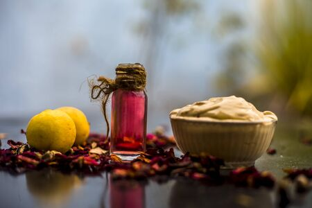 Best cheap DIY face mask for acne scars of multani mitti or fullers earth or mulpani mitti on the wooden surface consisting of lemon juice, fullers earth, and some rose water also.