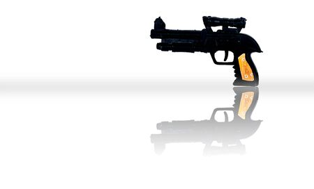 Black colored plastic toy gun isolated on white.