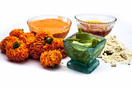 Marigold face mask for sensitive skin isolated on white consisting of some honey, marigold flowers, aloe vera gel, and some chickpea flour or gram flour or besan along with entire constituents.