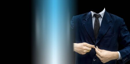 Faceless businessman or an employee or worker buttoning his suit buttons isolated against the digital background. Wide-angle high-resolution image. Stock Photo