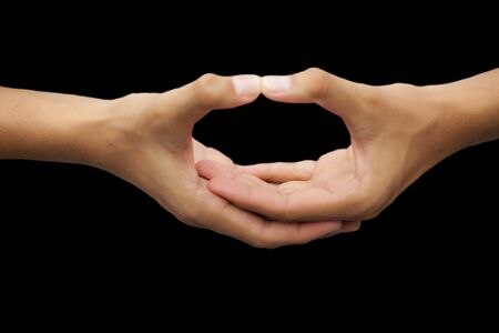 Isolated hands of a male teenager doing Dhyana Yoga Mudra practice which improves the concentration power. Stock Photo