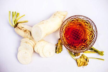 Close up shot of daikon with honey isolated on white background. Horizontal shot.