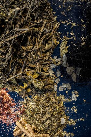 Best home ayurvedic remedy for ulcer i.e. Ardusi or Malabar nut, sugar, and mulethi or licorice. Shot of all the herbs on black surface with powder also. Standard-Bild