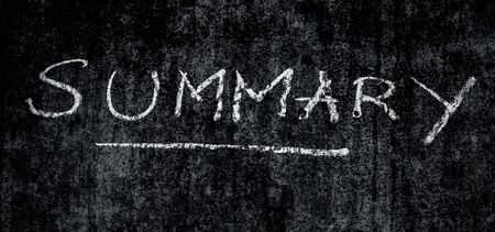 Creative shot of Summary word written on a rough wall with an underline under it.