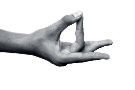 Human hand doing Akash Yoga Mudra isolated on a white-colored seamless background. Shot of single-hand demonstrating Akash Mudra.