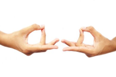 Human hands doing Akash Yoga Mudra isolated on a white-colored seamless background. Shot of pair of hands demonstrating Akash Mudra. Stock Photo