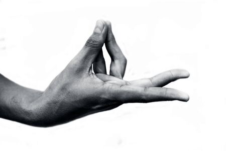 Close up shot of male hand demonstrating Prana Yoga Mudra isolated over white background. Horizontal shot.