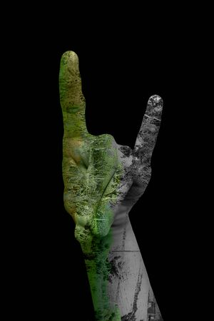 Double exposure shot of pair of hands with some hand sign and having healing nature. Concept of Care for mother nature. Stock Photo