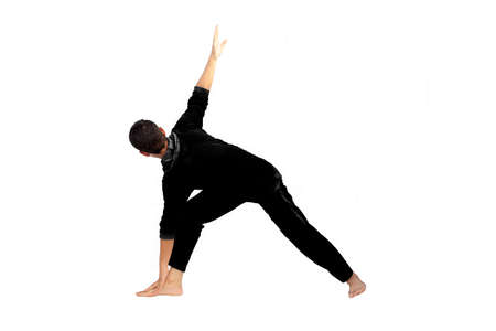 Full-length shot of male teenager practicing Yoga Pose isolated on white