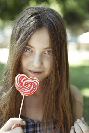 Girl with coloring lollipop photo
