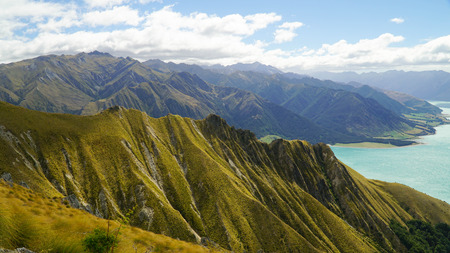 Dramatic features of the Southern Alps with blue lake in the background, New Zealand