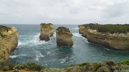 Two isolated cliffs and rock formations along The Great Ocean Road, caused by water erosion, Australia Stock fotó