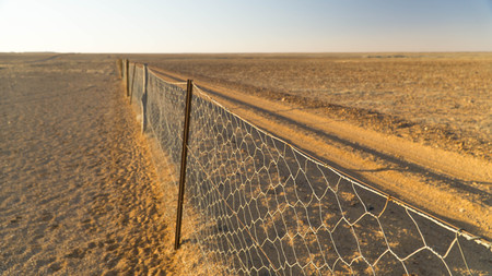 View of Famous Dog Fence in Kanku Breakaways Conservation Park near Coober Pedy, Australia