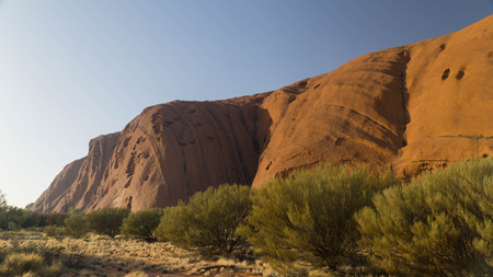 Walking around mystical Ayers Rock (Uluru), located in Red Center of Australia Reklamní fotografie