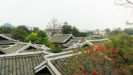 Traditional roofs of buildings in China. Ancient city Yangshuo, China