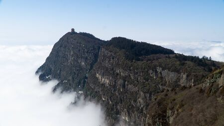 The hightest peak (3077m a.s.l.) of sacred mountain Mount Emei, pagoda above clouds, China